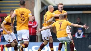 Motherwell rescued a point in a six-goal thriller