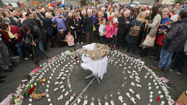 People gather to protest at the site of the former Tuam home for unmarried mothers at the same time as Pope Francis held a mass in Dublin. Photo: Niall Carson PA Images/Getty Images