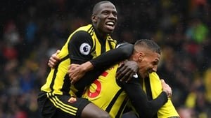 Jose Holebas of Watford is mobbed by team-mates after scoring the winner