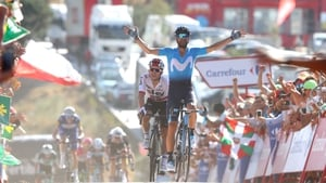 Alejandro Valverde raises his arms in celebration at the finish line
