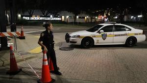 Police cordon off the area around the scene of the attack