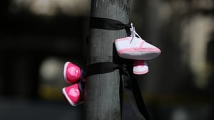 Baby shoes tied to a lamp post during a protest against mother-and-baby homes