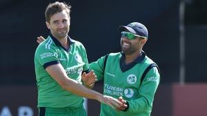 Ireland's Tim Murtagh (L) celebrates after dismissing Gulbadin Naib of Afghanistan