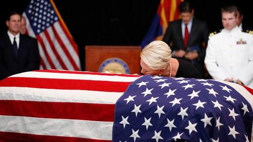 Cindy McCain kisses her late husband's casket during the memorial service