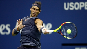 Rafael Nadal hits a shot  against Vasek Pospisil