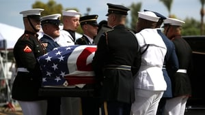 Military pallbearers carry the casket of John McCain in to a memorial service at the North Phoenix Baptist Church