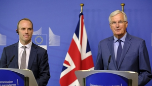 Dominic Raab (L) and Michel Barnier held talks in Belgium today