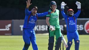 Afghanistan's Rashid Khan (L) appeals for lbw against Ireland's Kevin O'Brien