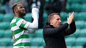 Brendan Rodgers (R) and Moussa Dembele in happier times
