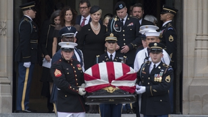 John McCain's wife Cindy, and their son Jimmy, follow an honour guard carrying his casket out of the the National Cathedral in Washington