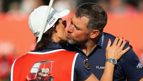 Westwood of England kisses his girlfriend and caddie, Helen Storey