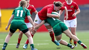 Catherine Martin of Connacht tackles Munster's Roisin Ormond and