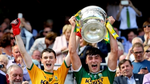 Kerry goalkeeper Marc Kelliher and Paul O'Shea lift the Tom Markham Cup.