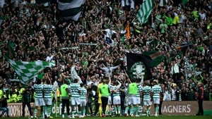 Celtic are cheered off the field after their defeat of Rangers