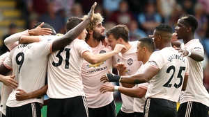 Manchester United players mob Romelu Lukaku after his first goal