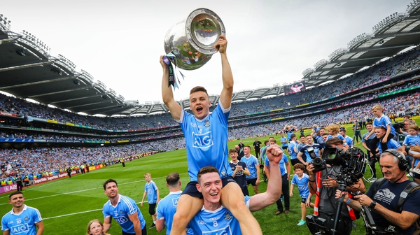 Eoin Murchan holds the Sam Maguire trophy aloft on the shoulders of Brian Fenton