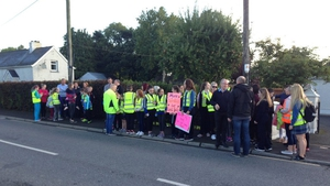 Students and their parents walked with placards to their school in Trim