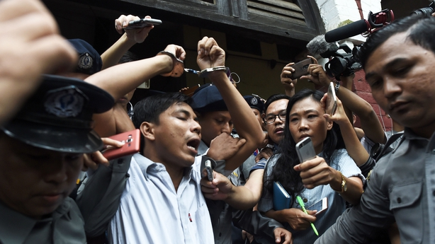 Journalist Kyaw Soe Oo is escorted from the court after being sentenced