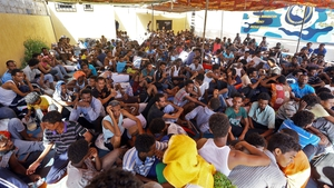 Migrants inside a shelter in Tripoli