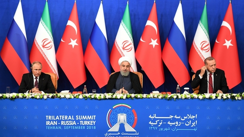 Vladimir Putin, Hassan Rouhani and Recep Tayyip Erdogan at a press conference after meeting on Syria in Tehran