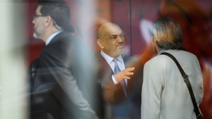 Yemen's foreign minister Khaled al-Yamani (C) speaks with members of his delegation in Geneva