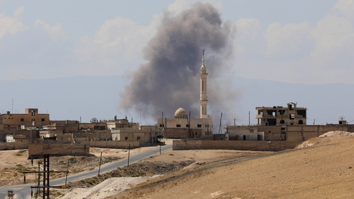 Smoke billows following Syrian government forces' bombardment around the town of Khan Sheikhun on the southern edge of Idlib