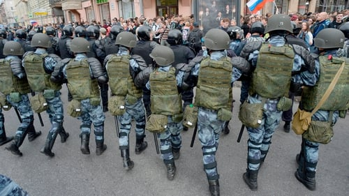 Russian police block a street during a protest rally in Saint Petersburg today