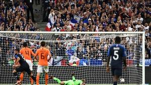 Olivier Giroud turns away after scoring the winner in Paris