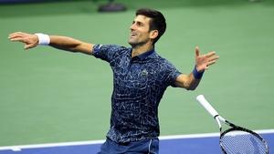 Novak Djokovic drops his racquet after winning match point
