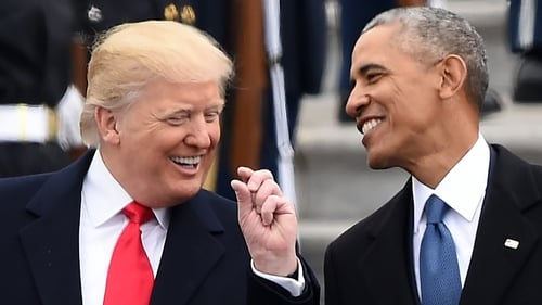 Donald Trump and Barack Obama share a joke at Mr Trump's inauguration