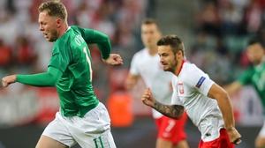 Ireland's Aiden O'Brien evades Karol Linetty