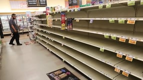 Bread shelves in a shop are bare as people stock up on food ahead of the arrival of Hurricane Florence in Myrtle Beach, South Carolina