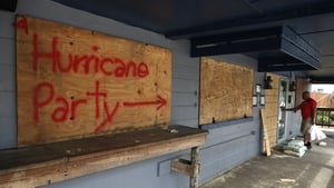 'Hurricane Party' is written on plywood covering the window of the Lager Heads Tavern in Wrightsville Beach