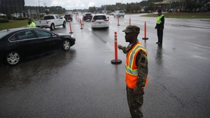 The South Carolina National Guard directs traffic as the South Carolina government ordered that traffic use all lanes leading away from the coast to facilitate the evacuation