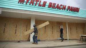 Locals board the windows of a business in Myrtle Beach, South Carolina