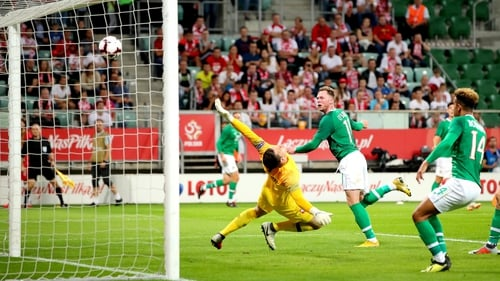 Aiden O'Brien heads home, marking his debut with a goal in Wroclaw