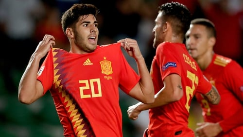Marco Asensio celebrates scoring Spain's second goal