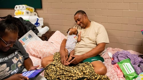 Avair Vereen, her fiance and their baby take shelter at a school in Conway South Carolina