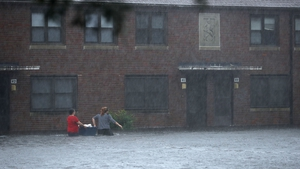 Residents wade through floodwater to retrieve belongings after the Neuse River went over its banks in New Bern