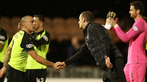 Scott Brown of Celtic and St Mirren boss Oran Kearney shake hands after the game