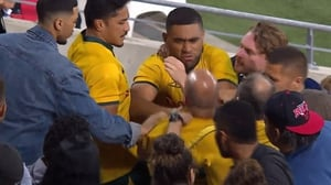 Wallaby flanker Lukhan Tui tussles with a fan in the stands after Australia's loss to Argentina in the Gold Coast