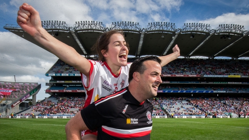 A jubilant Aine Canavan is carried by Damien Corrigan after Tyrone's win