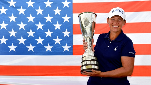 Angela Stanford of the United States poses with the trophy after her victory in the Evian Championship