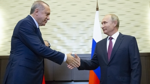 Russia's Vladimir Putin and Turkey's Recep Tayyip Erdogan shake hands during their meeting
