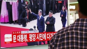 A South Korean watches TV footage of North Korean leader Kim Jong-un welcoming South Korean President Moon Jae-in