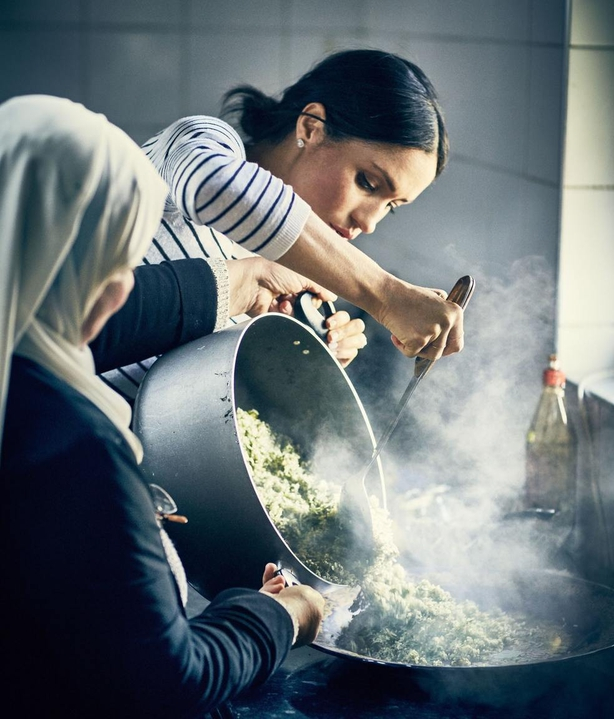 Duchess of Sussex cooking with women in the Hubb Community Kitchen at the Al Manaar Muslim Cultural Heritage Centre (Jenny Zarins/PA)