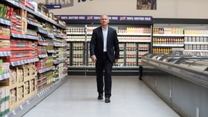 Tesco's chief executive Dave Lewis said he plans to step down next summer