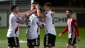 Bohemians players celebrate their success at The Brandywell