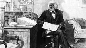 Frederick Douglass edits a journal at his desk, late 1870s. Photo: Hulton Archive/Getty Images