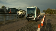 The EZ10 shuttle makes its way alongside the Liffey